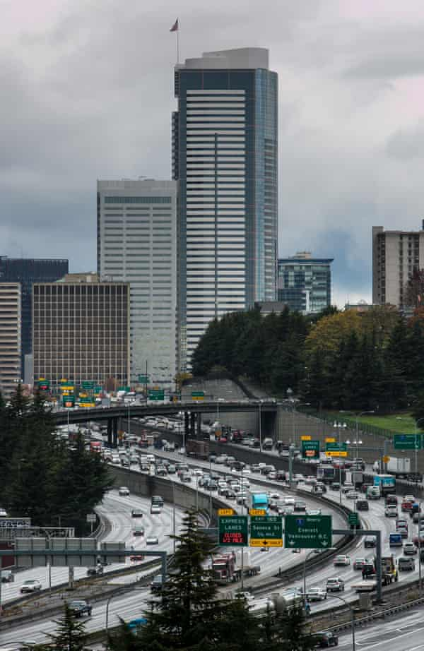The downtown Seattle skyline shrouded in rain and clouds. About a one third of the city's climate footprint comes from buildings, in large part from burning 'natural' gas for heating and cooking.