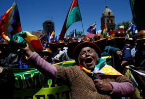 A female supporter of Bolivian President Evo Morales shows her support during a march in La Paz, Bolivia, Wednesday, Oct. 23, 2019. Morales said Wednesday his opponents are trying to stage a coup against him as protests grow over a disputed election he claims he won outright, though a nearly finished vote count suggests it might head to a second round.