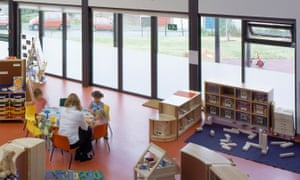 A Sure Start centre with children and nursery worker