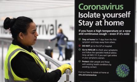 Sign about coronavirus at Heathrow airport