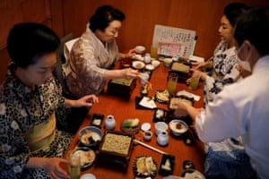 Maki, Ikuko, Mayu and Koiku, who are geisha, eat soba noodles at a restaurant after attending a dance class
