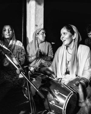 Women singing at night to celebrate Janmasthami