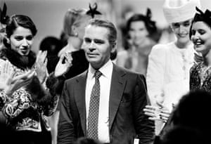 Designer Karl Lagerfeld is applauded by his models at the end of the presentation of Chanel's Autumn/Winter haute couture collection in Paris, France, 1983