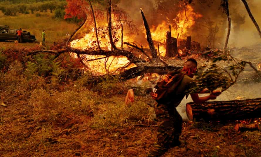 Volunteer firefighters tackle a wildfire near Kamaria in Evia, Greece, in August.