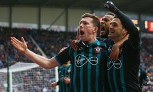 Southampton's Pierre-Emile Højbjerg celebrates his goal with Dusan Tadic and Ryan Bertrand at DW Stadium on Sunday.