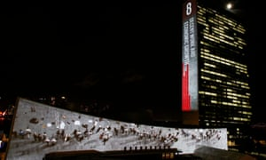 A projection of the eighth global goal, on economic growth and employment, illuminates the UN building in New York.