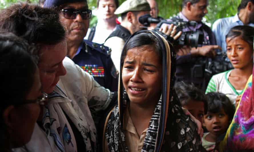 Karen Pierce, the UK ambassador to the UN, consoles a 12-year-old Rohingya refugee near Cox's Bazar, in Bangladesh.