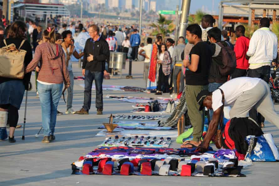 Illegal sellers of fake branded clothes on Barceloneta beach