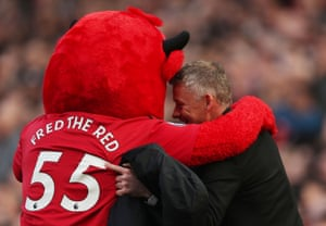 Ole Gunnar Solskjaer gets a pre-match hug from Fred the Red.