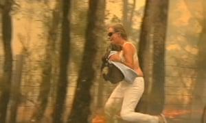 Toni Doherty saving Lewis the koala from the bushfire
