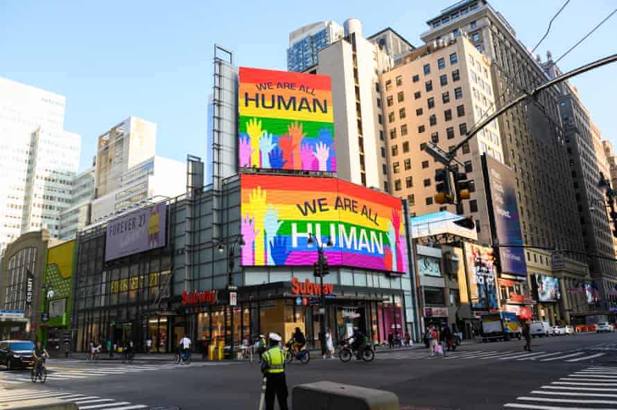 'We are all human' billboards light up in Pride colors in New York in June.