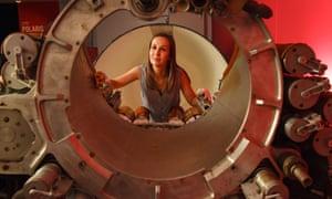 Kate Braun, Royal Navy submarine museum curator, looks through a Polaris missile re-entry vehicle