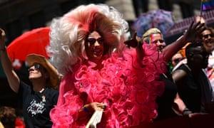 Marchers pass the Stonewall Inn.