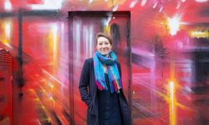 Woman in front of street art