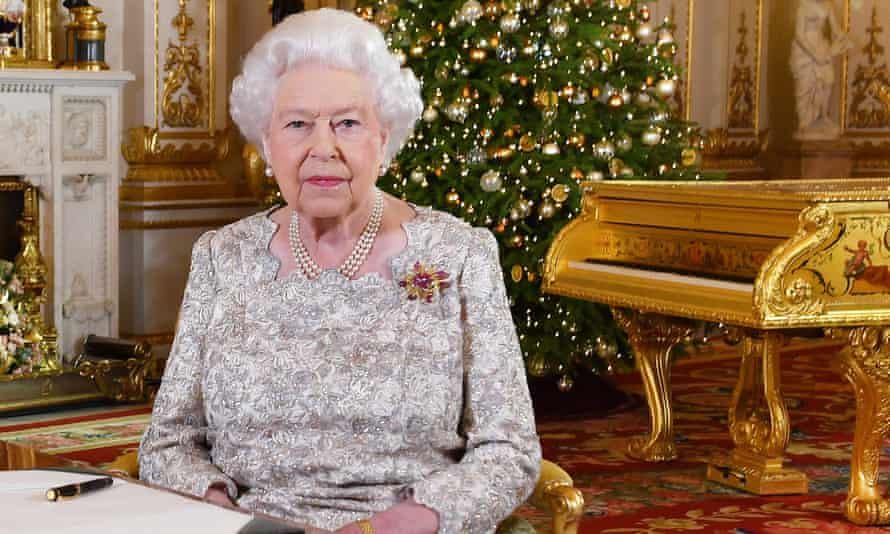 Queen Elizabeth II poses with the offending instrument in the background