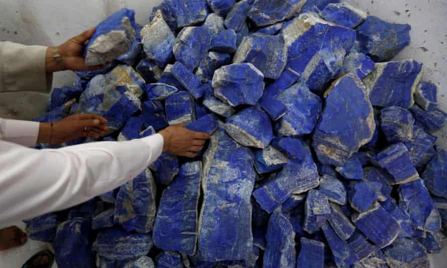 Men sort lapis lazuli inside a shop in Kabul, Afghanistan