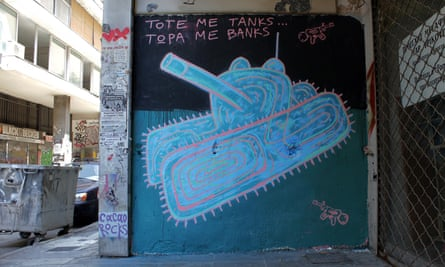 'Then they used tanks. Now they use banks'. Mural and photograph by Cacao Rocks