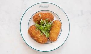 Three shrimp croquettes on a plate