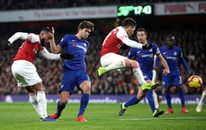 Alexandre Lacazette drills in Arsenal's opening goal after three clever touches in the tightest of spaces.