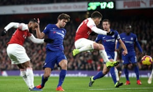 Arsenal's Alexandre Lacazette (left) scores his side's first of the 2-0 Premier League win over Chelsea in January.