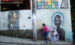 Tributes to Mandela and Gandhi on a wall of the Babilonia favela.