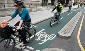 A cyclist in a segregated cycle lane in London.