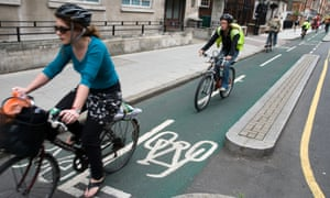 Cyclists riding in segregated cycling lane, London