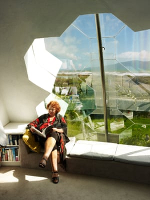 Coastal views: Helen Eisenhofer reads on the dome's bespoke leather bench seating