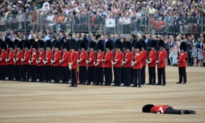A soldier collapses on Horse Guards Parade ahead of the Queen's Birthday Parade