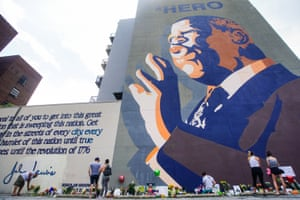 Atlanta: People pay their respects at a makeshift memorial at the base of a mural of civil rights hero John Lewis