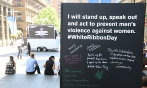Signs in Martin Place, Sydney, promote White Ribbon Day