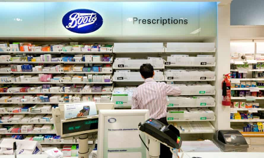 A back view of a pharmacist working in Boots the Chemist