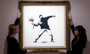 'Love is in the Air' by Banksy, one of the artists now finding a new market. Photograph: Justin Tallis/AFP/Getty Images