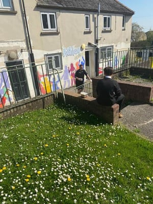 Gavin Gibbs, from Torfaen Youth Service, talking to a care leaver outside Ashley House Youth Club, Cwmbran.
