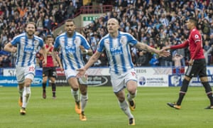 Aaron Mooy celebrates giving Huddersfield the lead against Manchester United