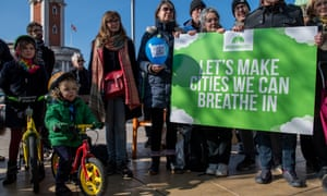 Green party supporters call on the government to clean up Britain's air on Brixton Road, London, which had already reached the annual legal air pollution limit by the end of January 2018.