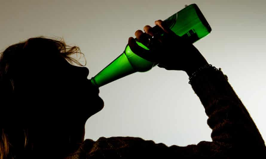 Woman drinking alcohol from a bottle