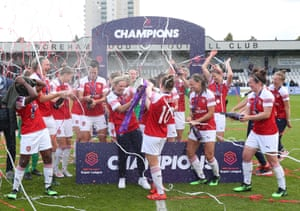 Arsenal celebrate winning the Women's Super League after the game against Manchester City on 11 May.
