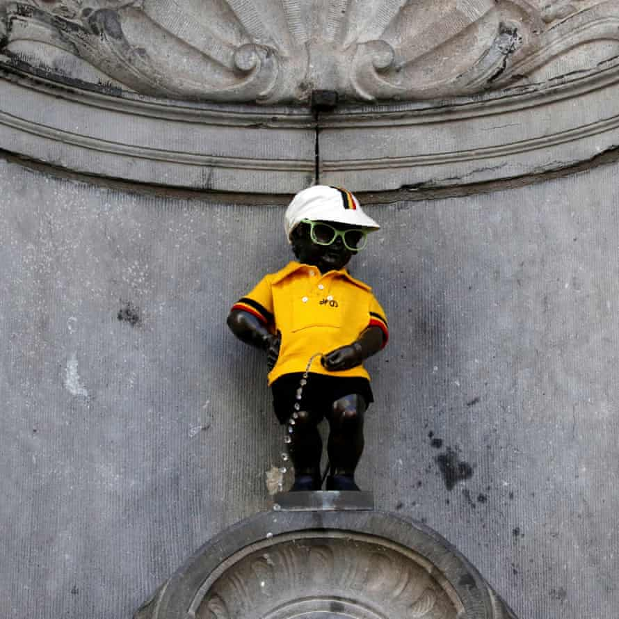 Brussel's Manneken Pis is dressed in the overall leader's yellow jersey, before the start of the first stage.