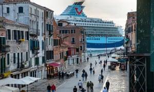 A Tui cruise ship passes along the Giudecca Canal, as seen from Via Garibaldi, Venice.