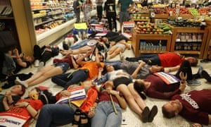 Protesters participate in a 'die-in' at a Publix supermarket in Coral Springs, Florida.