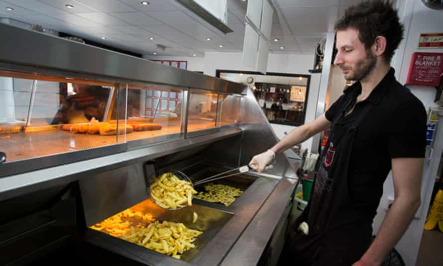 Alexi fries up chips.