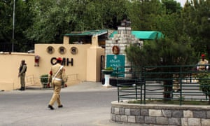 Pakistani soldiers stand guard outside a military hospital in Gilgit