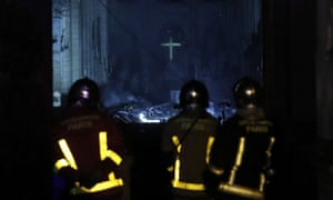 French firefighters enter the Notre Dame cathedral as flames are burning the roof in Paris, France.