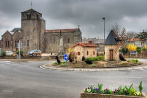 Clessé, France. This roundabout features a miniature windmill and watermill - both of which are turning