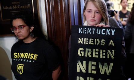 Young protesters with the Sunrise Movement in Washington on Monday. The activists from Kentucky said they have repeatedly sought meetings with McConnell.