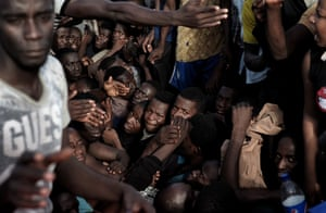 Migrants crammed into a boat waiting to be rescued