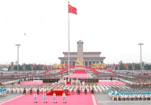 Representatives of the Chinese Communist Youth League members and Young Pioneers salute the Communist Party of China