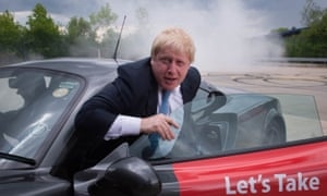 Boris Johnson emerges from a Ginetta sport car after a Vote Leave visit to the Ginetta factory in West Yorkshire.