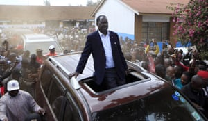 Kenyan Opposition leader Raila Odinga drives passing his supporters after casting his vote in Kibera
